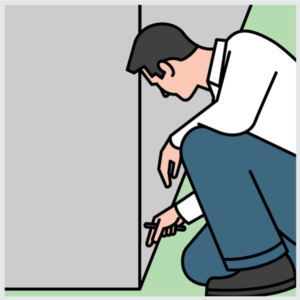 Image of a pest control technician inspecting for termites.